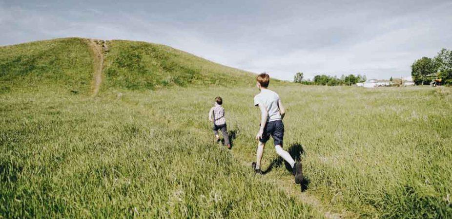 Boys running outdoors