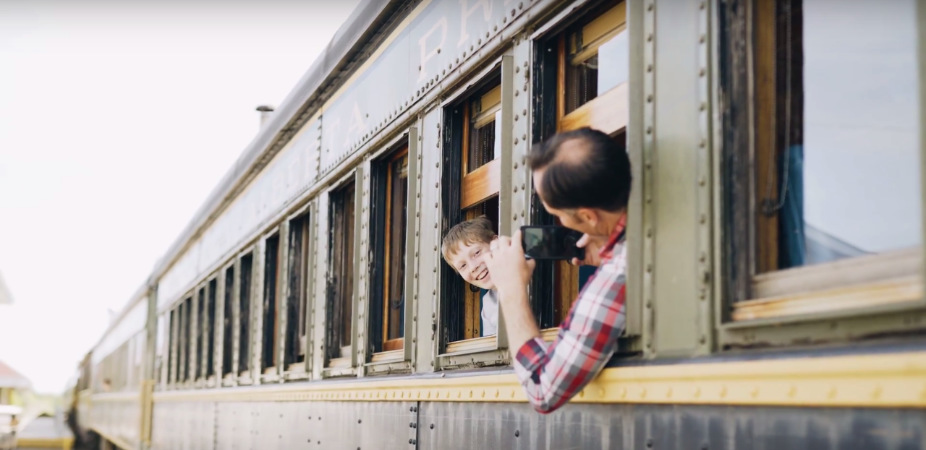 Father and son on train in Stettler